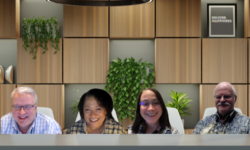 4 people in one conference room background